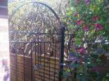 arched-top-metal-garden-gate