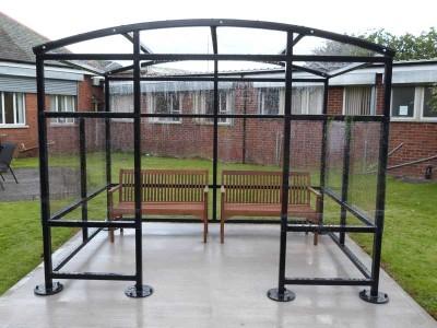 curved steel smoking sheltereverton day centre belfast